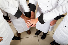 Chef teamwork. Group of professional chef put hand together to form a teamwork gesture Royalty Free Stock Image
