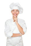 Chef thinking looking. Smiling and happy to the side. Woman chef, cook or baker in chef uniform and hat. Young asian female isolated on white background Stock Photos