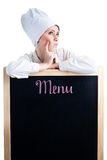 Chef thinking about lunch menu. Leaning on blackboard stock photography