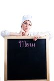 Chef thinking about menu. To write on blackboard Royalty Free Stock Image