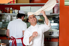 Chef throwing up thin base dough Stock Photos