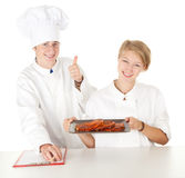 Chef with thumb up examining cook, Stock Image