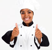 Chef thumbs up. Half length portrait of african american female chef thumbs up Royalty Free Stock Photos