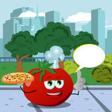 Chef tomato holding pizza with attitude in the city park with speech bubble Royalty Free Stock Image