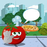 Chef tomato with pizza holding a stop sign in the city park with speech bubble Royalty Free Stock Photo