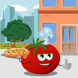 Chef tomato with pizza showing thumb up in the city Royalty Free Stock Photography
