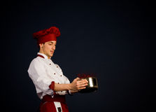 Chef with tomato sauce Royalty Free Stock Images