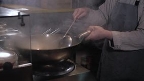 Chef Tossing Fried Vegetables And Meat With Fire In a Frying Pan, Commercial Kitchen Cooking stock footage