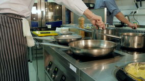 Chef tossing and stirring dishes on the stove stock video footage