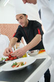 Chef training students in cooking class Stock Image
