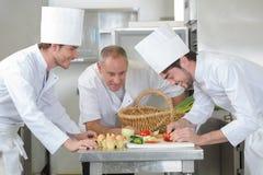Chef training students in restaurant kitchen stock photo