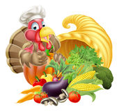 Chef Turkey and Cornucopia. Thanksgiving golden horn of plenty cornucopia full of vegetables and fruit produce with cartoon turkey bird wearing a chef hat Royalty Free Stock Photos