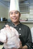 Chef with turkey poultry Royalty Free Stock Photos