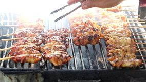 Chef turns the meat on the grill grate stock video footage