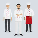 Chef and two cook in uniform standing together in three different poses. Cooking people characters. Royalty Free Stock Photo
