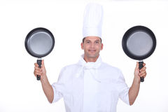 Chef with two pans Stock Photos