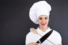 Chef in uniform holding a kitchen knife and spoon Royalty Free Stock Photo