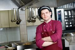 Chef in uniform at kitchen Stock Photo