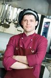 Chef in uniform at kitchen Stock Photos