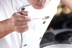 Chef used the spoon for taste soup of Japanese pork curry Stock Photo