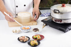 Chef using chopsticks hold Chinese dumpling Royalty Free Stock Photo