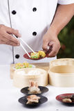 Chef using chopsticks hold Chinese dumpling Royalty Free Stock Photography