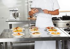 Chef Using Digital Computer In Kitchen Royalty Free Stock Photo