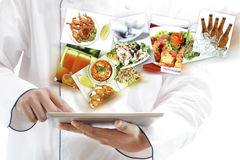 Chef using digital tablet stock photos