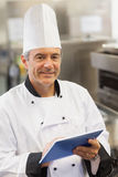 Chef using digital tablet Royalty Free Stock Image