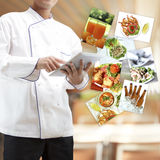 Chef using digital tablet Royalty Free Stock Photos
