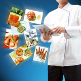 Chef using digital tablet Stock Image