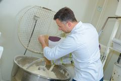 Chef using industrial mixer Royalty Free Stock Photography