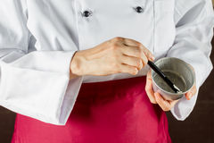 Chef using pastry brush Royalty Free Stock Photos