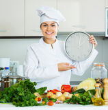 Chef with vegetables and clock Royalty Free Stock Images