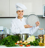 Chef with vegetables and clock Stock Photography