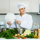 Chef with vegetables and clock Royalty Free Stock Photo