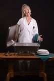 Chef viewing buffet. Passive posed uniformed female Chef viewing a buffet table Stock Image