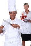 Chef and waitress her Stock Images