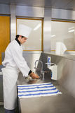Chef washing hands. In the restaurant Royalty Free Stock Photo