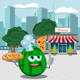 Chef watermelon holding pizza with attitude in front of a restaurant Royalty Free Stock Image