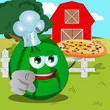 Chef watermelon with pizza pointing at viewer on a farm Stock Photo