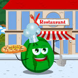 Chef watermelon with pizza showing thumb up in front of a restaurant Royalty Free Stock Photo