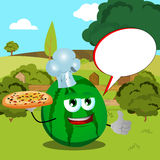 Chef watermelon with pizza showing thumb up on a meadow with speech bubble Stock Photos