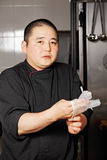 Chef wearing on gloves Stock Images