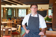 Chef Wearing Whites And Apron Sitting In Restaurant Stock Images