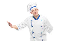 A chef welcoming Stock Photography