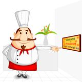 Chef welcoming in Restaurant Stock Photography
