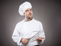 Chef with whick thinking Royalty Free Stock Images