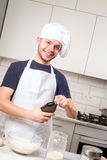 Chef whisked eggs and meal in a bowl Stock Photography