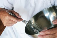 Chef Whisking Stock Photography